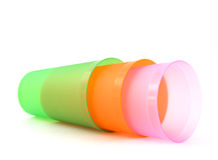 Green, orange and pink cups Stock Image