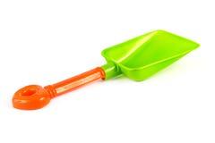 Green and orange plastic kids spade Royalty Free Stock Photo