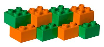 Green and orange plastic toy bricks Royalty Free Stock Photo