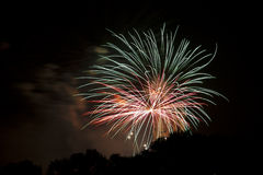 Green, orange and red fireworks Royalty Free Stock Photo