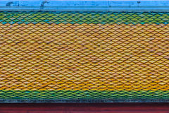 Green-orange roof tiles pattern on rooftop of Thai Buddhist chur Royalty Free Stock Photography