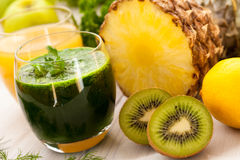 Green and orange smoothies. Green smoothie with fresh fruit and vegetable Royalty Free Stock Photography