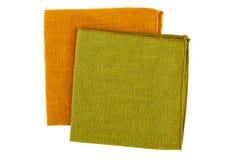 Green and orange textile napkins on white Royalty Free Stock Photos