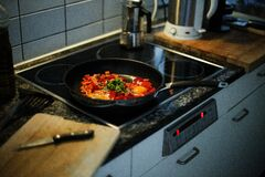 Green and Orange Vegetables on Black Frying Pan Royalty Free Stock Photo