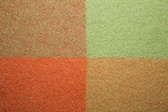Green and orange wool plaid texture macro shot Royalty Free Stock Photo