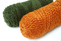 Green and orange yarn rolls Royalty Free Stock Images