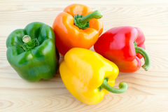 Green, orange, yellow and red bell pepper Stock Photo