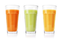 Green, orange and yellow smoothies Royalty Free Stock Photo