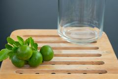 Green oranges and jar stock photography