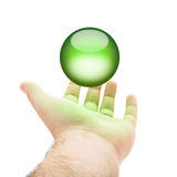 Green Orb Hand. A hand being held out with a green orb or round button hovering above Stock Photos