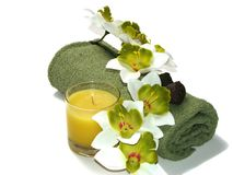 Green Orchid. A green-white orchid, green towel, and candle Stock Photography