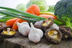 Green Organic, Fresh Vegetables, Broccoli, Vegan,. Organic vegetables, healthy food, fresh vegetables and ingredients on the table in the wood, mushrooms, garlic Royalty Free Stock Image