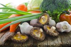 Green Organic, Fresh Vegetables, Broccoli, Vegan,. Organic vegetables, healthy food, fresh vegetables and ingredients on the table in the wood, mushrooms, garlic Stock Image