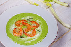 Green organic vegetable and creamy soup with shrimps. Royalty Free Stock Images