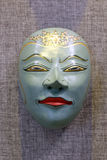 Green oriental goddess mask. In ancient oriental ritual, mask play an important role. mask have been given a mysterious religious and folk meaning. the mask is a Stock Photos