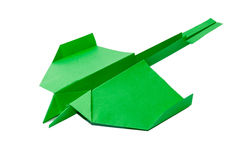 Green origami airplane with tail on the white background Royalty Free Stock Image