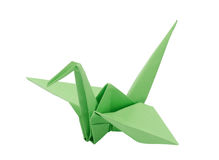 Green origami paper crane. Light Green origami paper crane. Isolated on white stock photo