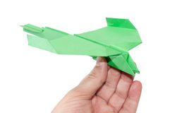 Green origami plane in the hand flying Stock Photography