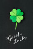 Green origami shamrock clover leaf paper background. St. Patrick Royalty Free Stock Photos