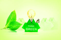 Green origami shirt paper Light bulb , Think green and eco frien Royalty Free Stock Images