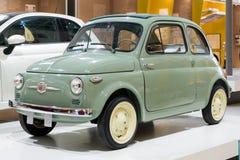 Green 1957 original Fiat 500 Italian car on display