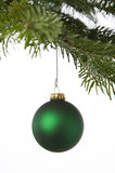 Green ornaments hanging from a Christmas tree Stock Photos