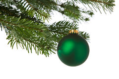 Green ornaments hanging from a Xmas tree Stock Photos