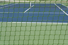 Green outdoor tennis court net Stock Photo