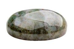 Green oval jasper cabochon. Oval dark green jasper cabochon on white Stock Photo
