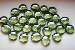 Green oval stones Stock Photos