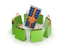 Green packets around solar battery. Royalty Free Stock Photo