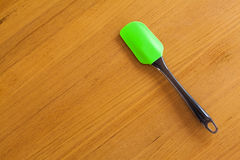 Green paddle on wooden background Royalty Free Stock Image