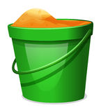 A green pail with sands Royalty Free Stock Images