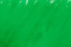 Green paint. Abstract green paint brush strokes watercolor background on white paper Stock Photo