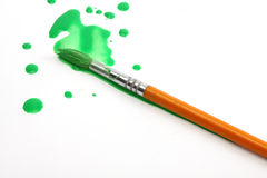 Green paint and brush Royalty Free Stock Images