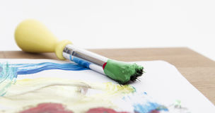 Green paint with brush Stock Images