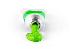 Green paint coming out of the tube Stock Photos