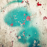 Green paint on concrete surface - toned filter. Red blotches. Royalty Free Stock Image