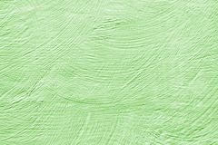 Green paint pastel. Paint strokes on the wall background stock image