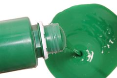 Green paint pouring in bucket Stock Photo