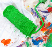 Green paint roller Stock Photography