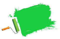 Green paint roller in action Royalty Free Stock Image
