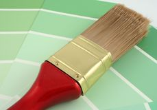 Green Paint Samples. A paint brush on green paint samples Stock Image