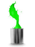 Green paint splashing out of can Royalty Free Stock Photos