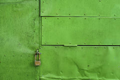 Green painted aluminium sheet background with rivets and lock Royalty Free Stock Images
