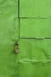 Green painted aluminium sheet background with rivets and lock Stock Photos