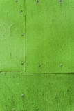 Green painted aluminium sheet background with rivets Royalty Free Stock Photos
