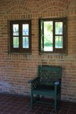 Green painted chair in brick alcove Royalty Free Stock Photo