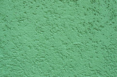 Green Painted Concrete Background. Green painted concrete or cement  surface to be used as background Royalty Free Stock Image