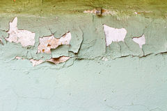 Green painted concrete wall texture with damaged and scratched surface. Abstract background stock photography